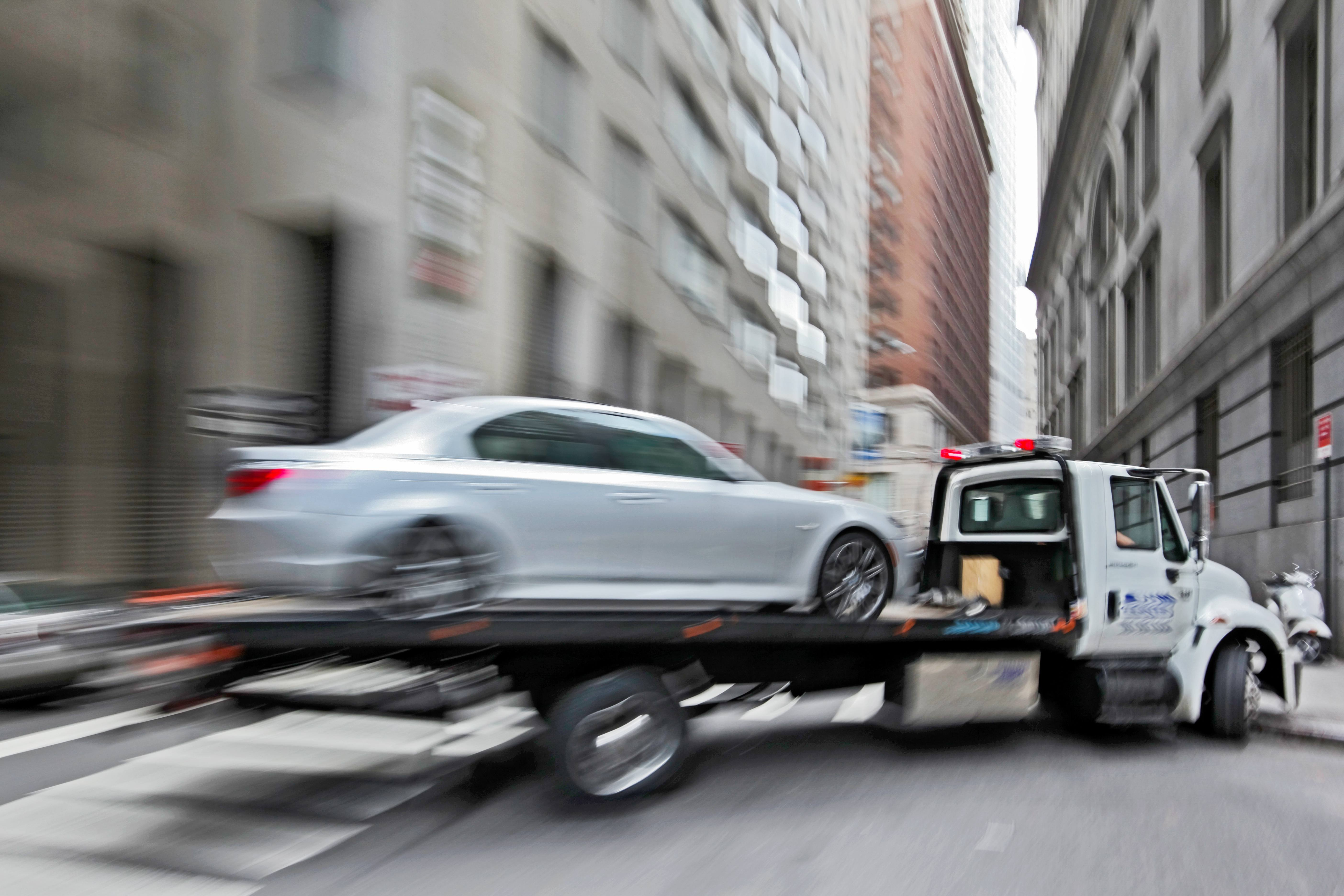 Tow truck and damaged vehicle | Wiers