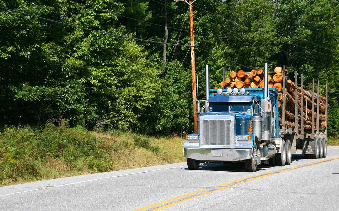 Logging truck on highway | Wiers